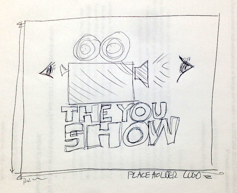 Initial You Show logo, drawn by hand on back of a  piece of printed paper.